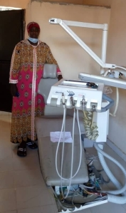 Fatou Gaye with dentist chair kind donation