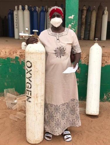 Fatou Gaye with oxygene bottles